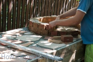 Laying bricks on wood fired pizza oven