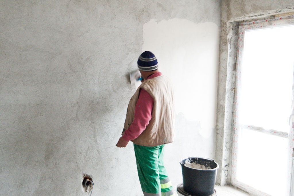 Applying plaster on the wall