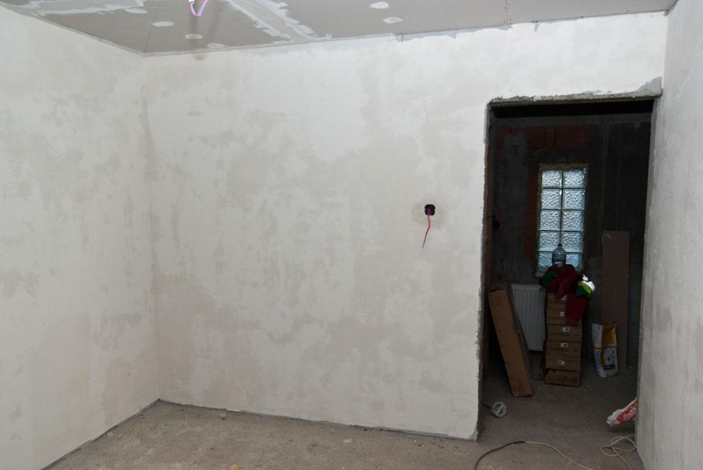 Applying the final coat of plaster