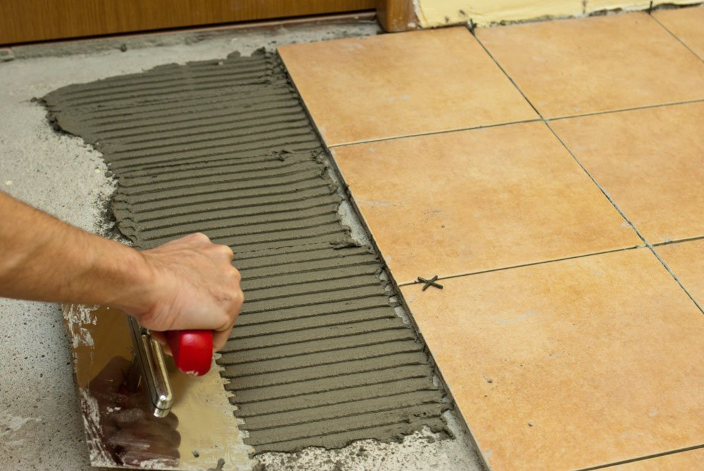 How To Spread Tile Adhesive Howtospecialist How To Build Step