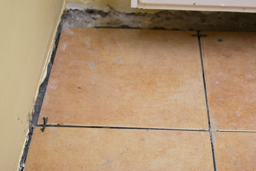 Laying tile on concrete floor