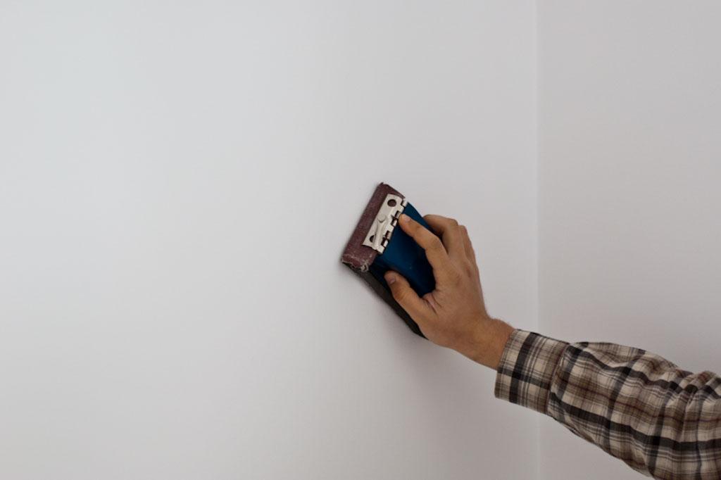 Sanding wall plaster