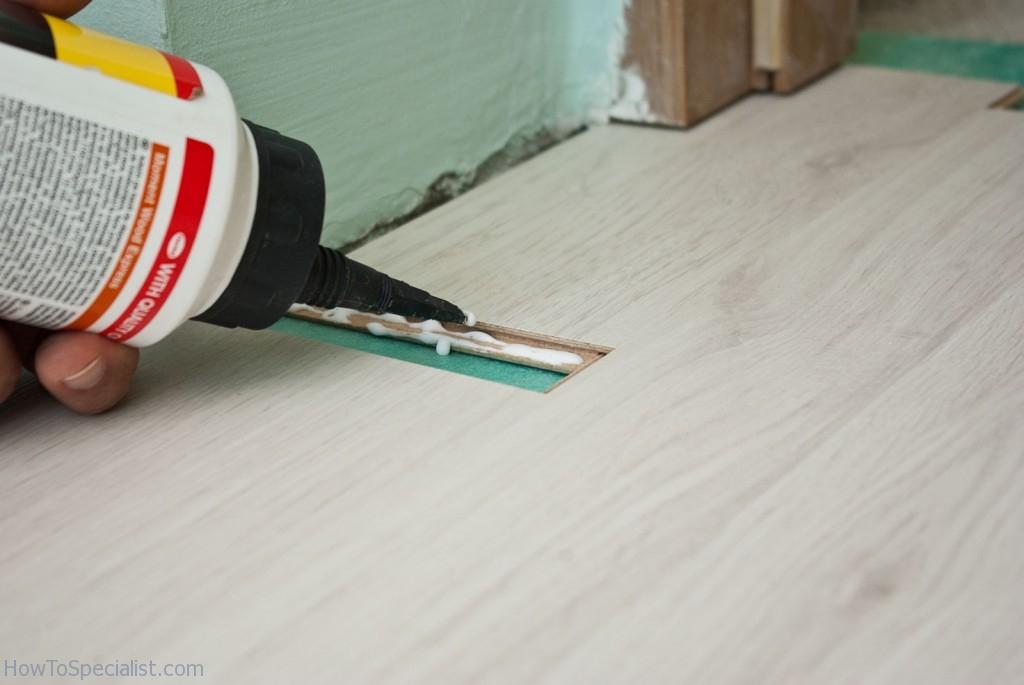 Installing laminate flooring under door jambs