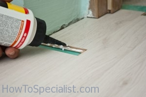 How To Install Laminate Floor Under Door - YouTube