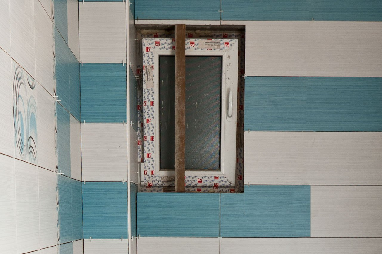 Tile around window