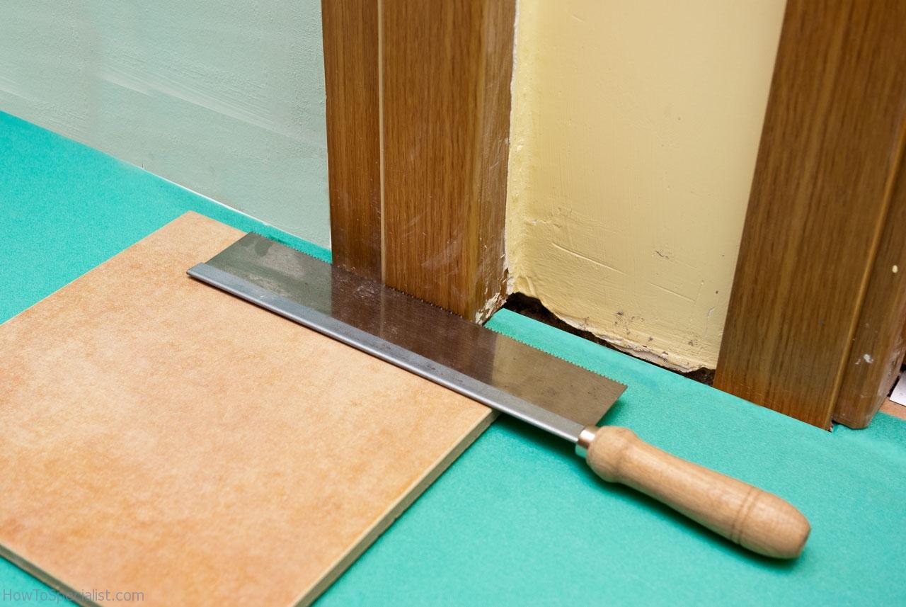 How to lay laminate flooring around doors