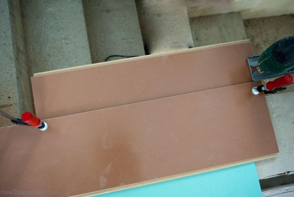 Cutting laminate flooring along wall