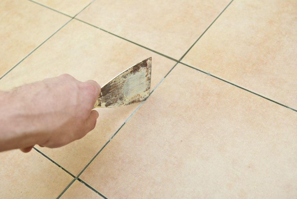 Removing adhesive between the tiles