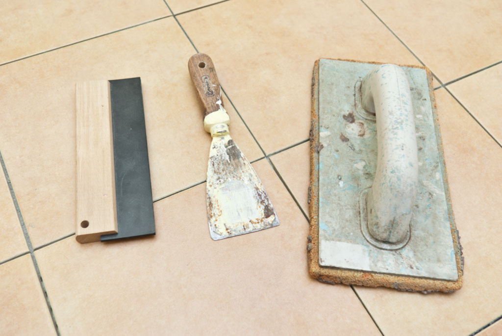 Tools for grouting floor tiles