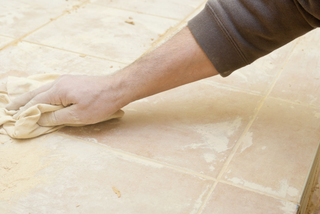 Cleaning grout of floor tiles