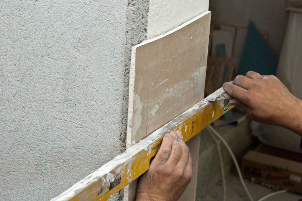 Scoring drywall with an utility knife