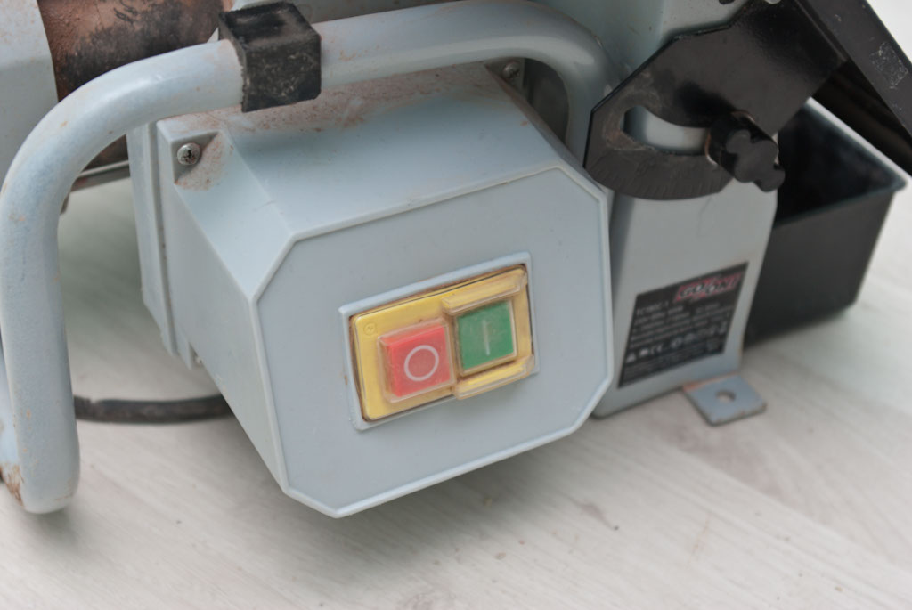 Wet saw start and stop buttons