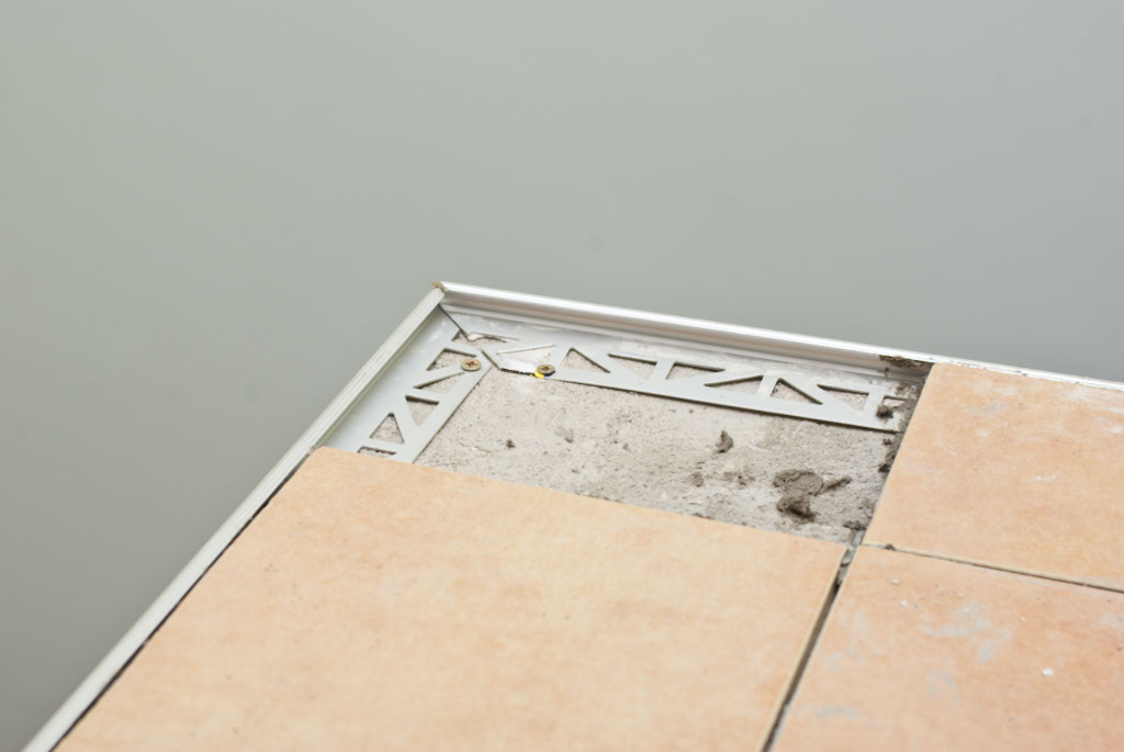 Cutting tile to fit into position