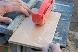 Using a wet saw to cut tiles