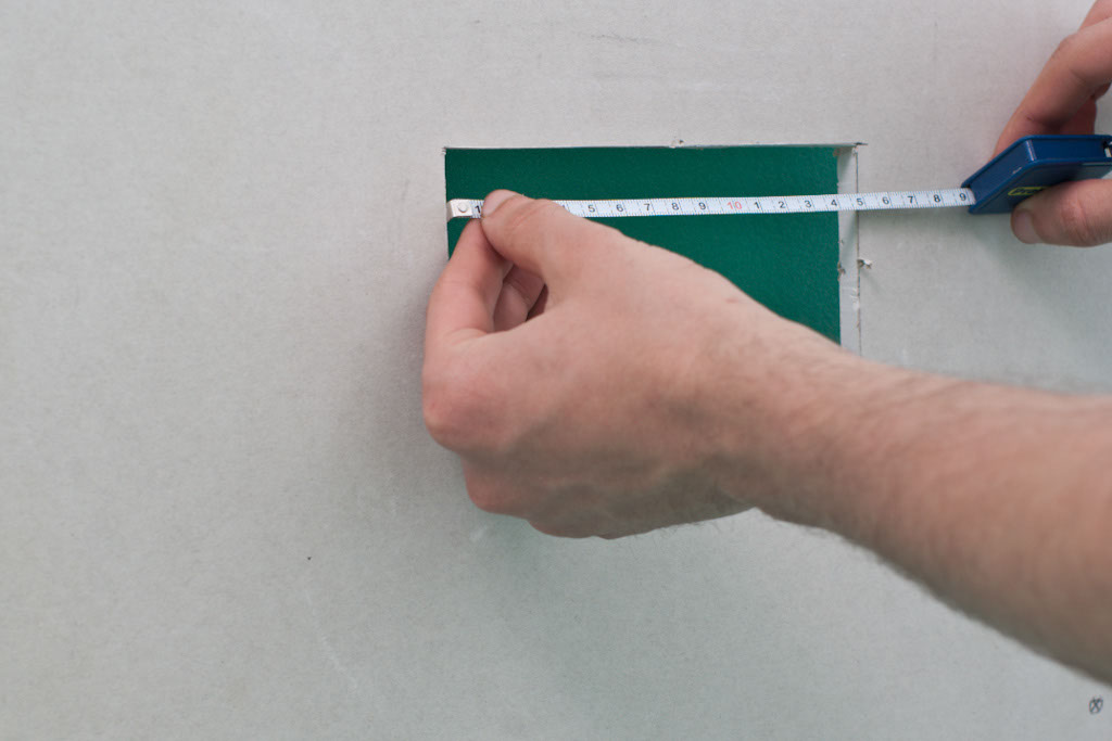 Measuring hole in drywall