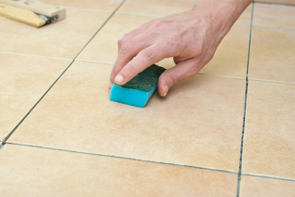 Spraying water on floor tiles