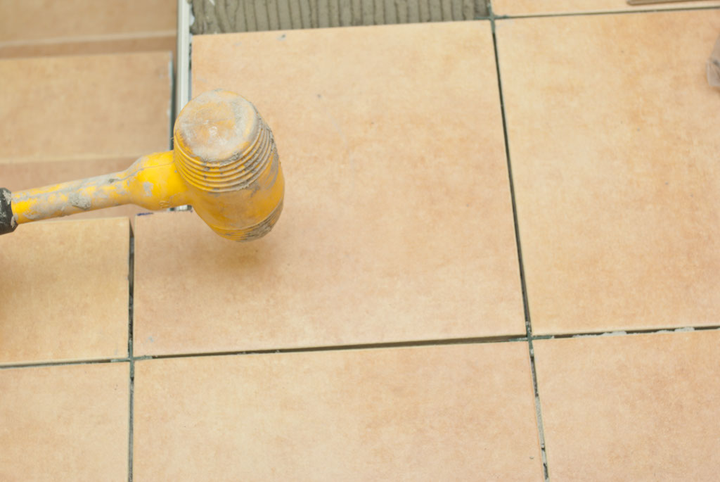 Setting tile into place