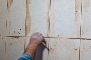 Removing excess grout between wall tiles