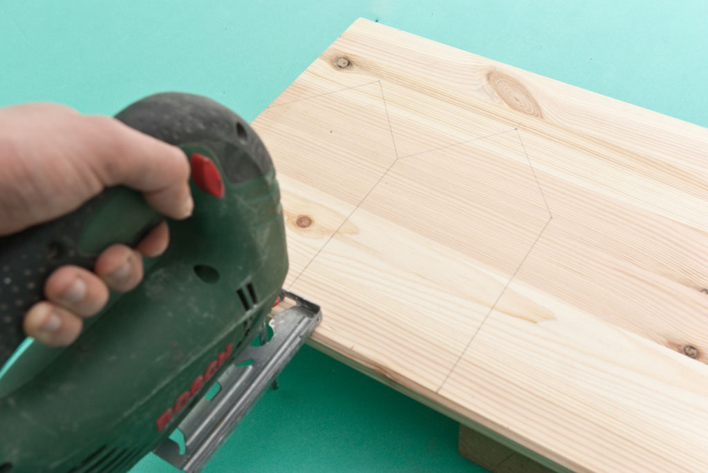 Cutting the wood boards with a jigsaw