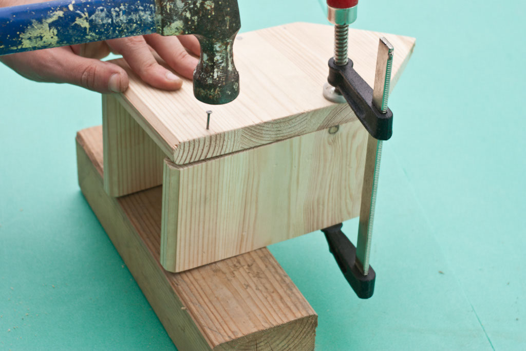 Locking together the front and sides of the birdhouse