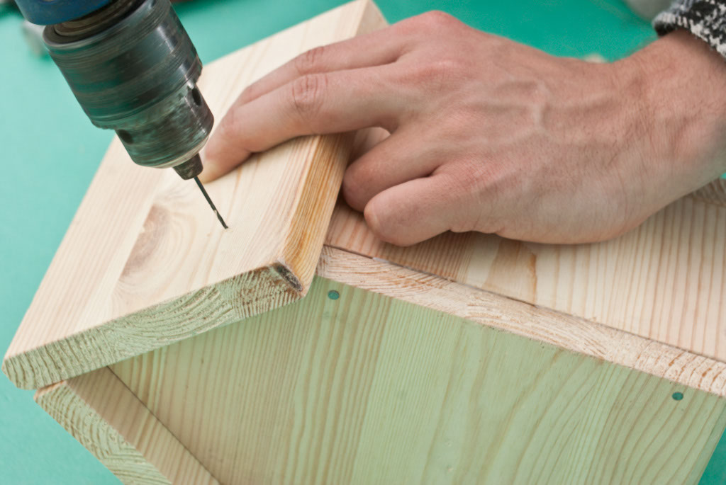 Predrilling holes before inserting the nails