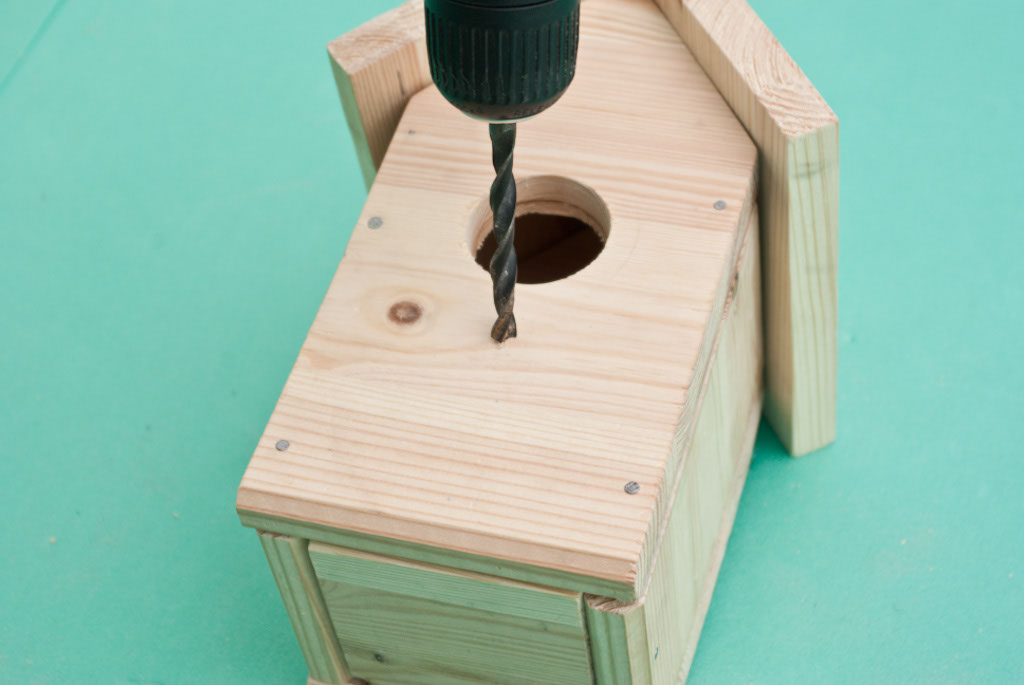 Drilling hole in the bird house