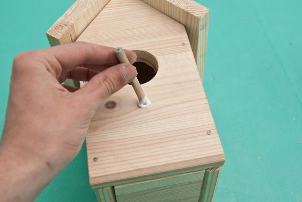 Installing the perch of the birdhouse