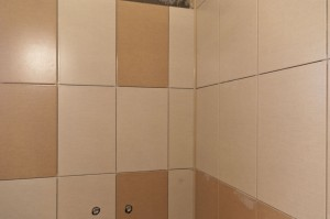 Grouting wall tiles