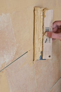 Grouting wall tiles with a float
