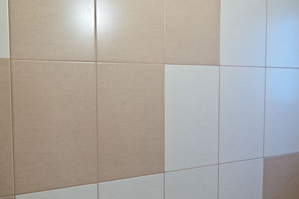 Grouting tile walls