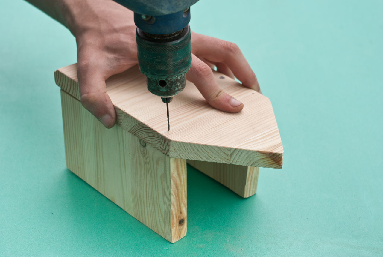Fastening the second side of the bird house
