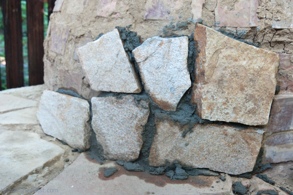 Covering the pizza oven with stone
