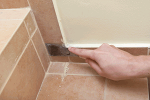 Removing hardened grout from tiles