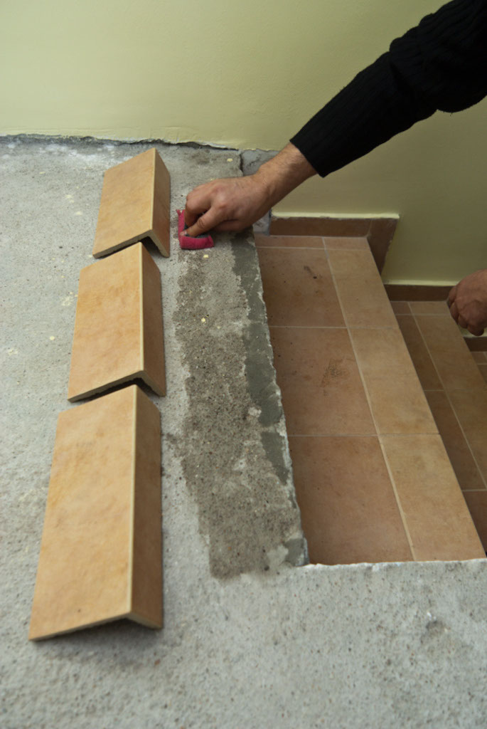 Spreading Tile Adhesive On Stairs Dripping Water Floor