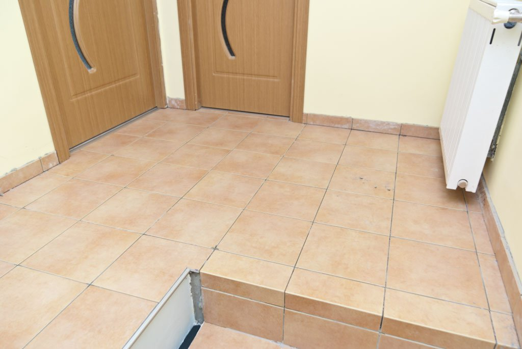 Grouting floor tiles | HowToSpecialist - How to Build ...